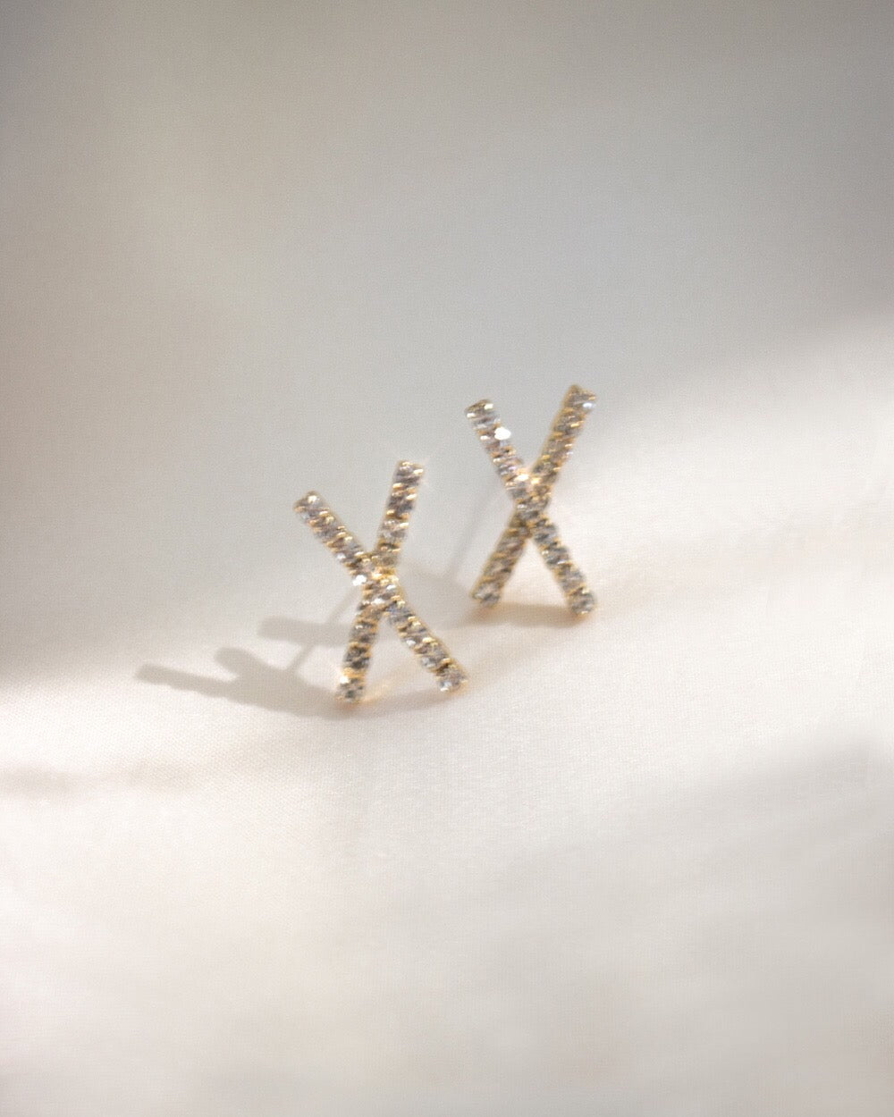 X shape ear studs encrusted with sparkly rhinestones - The Hexad