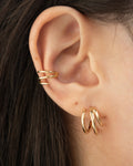 achieve the effect of multiple piercings with the hexad's illusion earrings like the triad cuffs and baby trio hoops