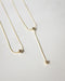 antidote two piece lariat necklace in gold | the hexad