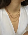 best selling rose gold chain necklaces from the hexad layered together to showcase a plunge neckline