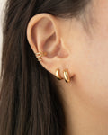 build a modern everyday ear stack with the timeless cuff and hoop earring designs from the hexad