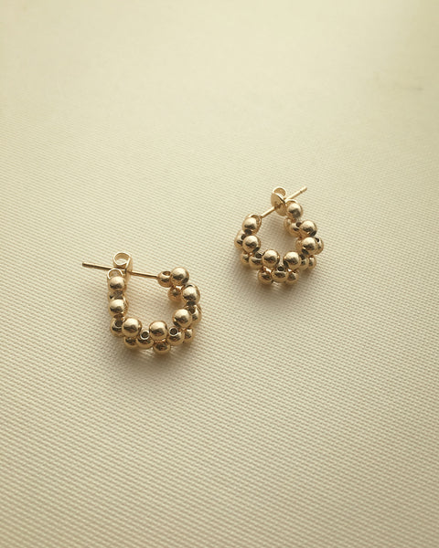 chic gold hoop earrings featuring tiny golden beads - The Hexad Jewelry