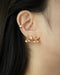 chic ear stack featuring tiny studs and ear cuffs by the hexad