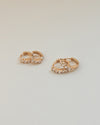 chic rose gold kira huggie hoop earrings designed for everyday ensemble @thehexad