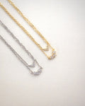 close up sparkly details of the aria necklace pendants in gold and silver - thehexad