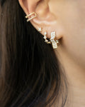contemporary ear stack featuring starry pearl earrings and astraea ear cuff