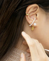 contemporary ear stack with pearl and gold elements by the hexad