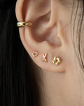 cut out heart earrings for a minimalist ear stack @thehexad
