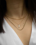 delicate chain necklaces with whimsical pendant engraved with stars