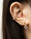 ear stack inspo styled by the hexad featuring its blaze ear cuff and micro stud earrings