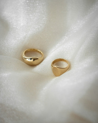 effortless ring stack with TheHexad's cocoon ring and oval signet ring