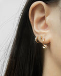fun huggie hoops with cute hanging charms for a quirky ear stack in modern rose gold