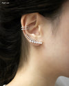 gala ear cuff worn on the right ear stacked with astraea cuff in silver