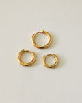 gold huggie hoop earrings in 3 sizes by the hexad
