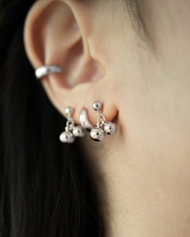 hoop earrings and mini ear studs layered for a perfect stack