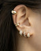 how to create the perfect ear stack with the hexad hoop earrings and ear cuffs