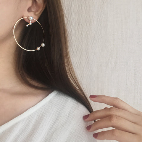 The Jaida Circle Earrings are made up of a circle frame dotted with faux pearl accents and a removable stud shaped in a mini constellation of three connecting faux pearls - The Hexad Jewelry