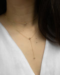 minimalist y necklace for plunging low necklines by the hexad