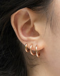 modern huggie hoops in rose gold | the hexad