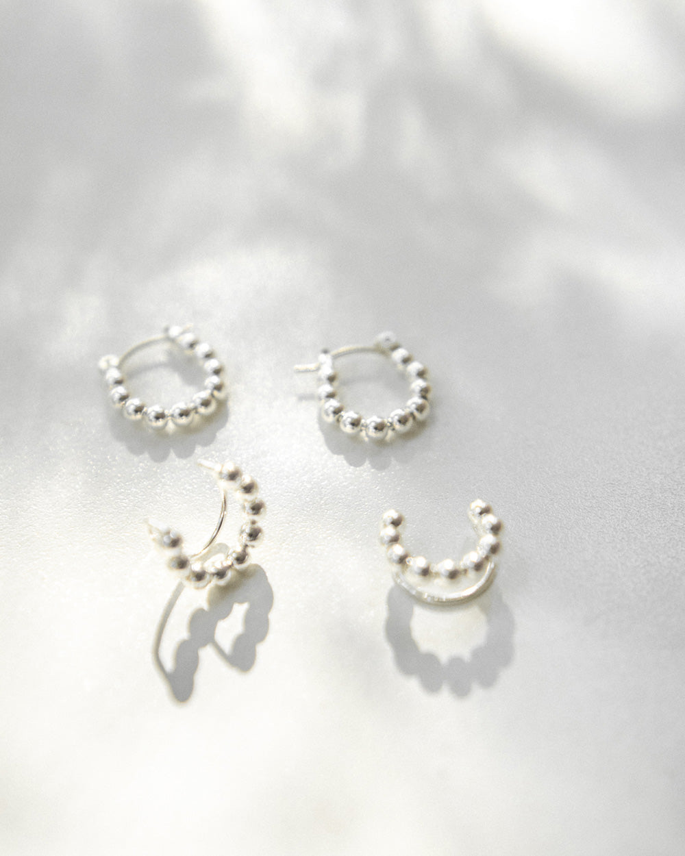 Modern style hoop earrings and ear cuffs for a silver ear stack