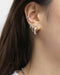 silver hoop earrings and cuffs for a modern ear party look styled by the hexad