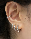 silver hoop earrings layered for a multi stack effect @thehexad