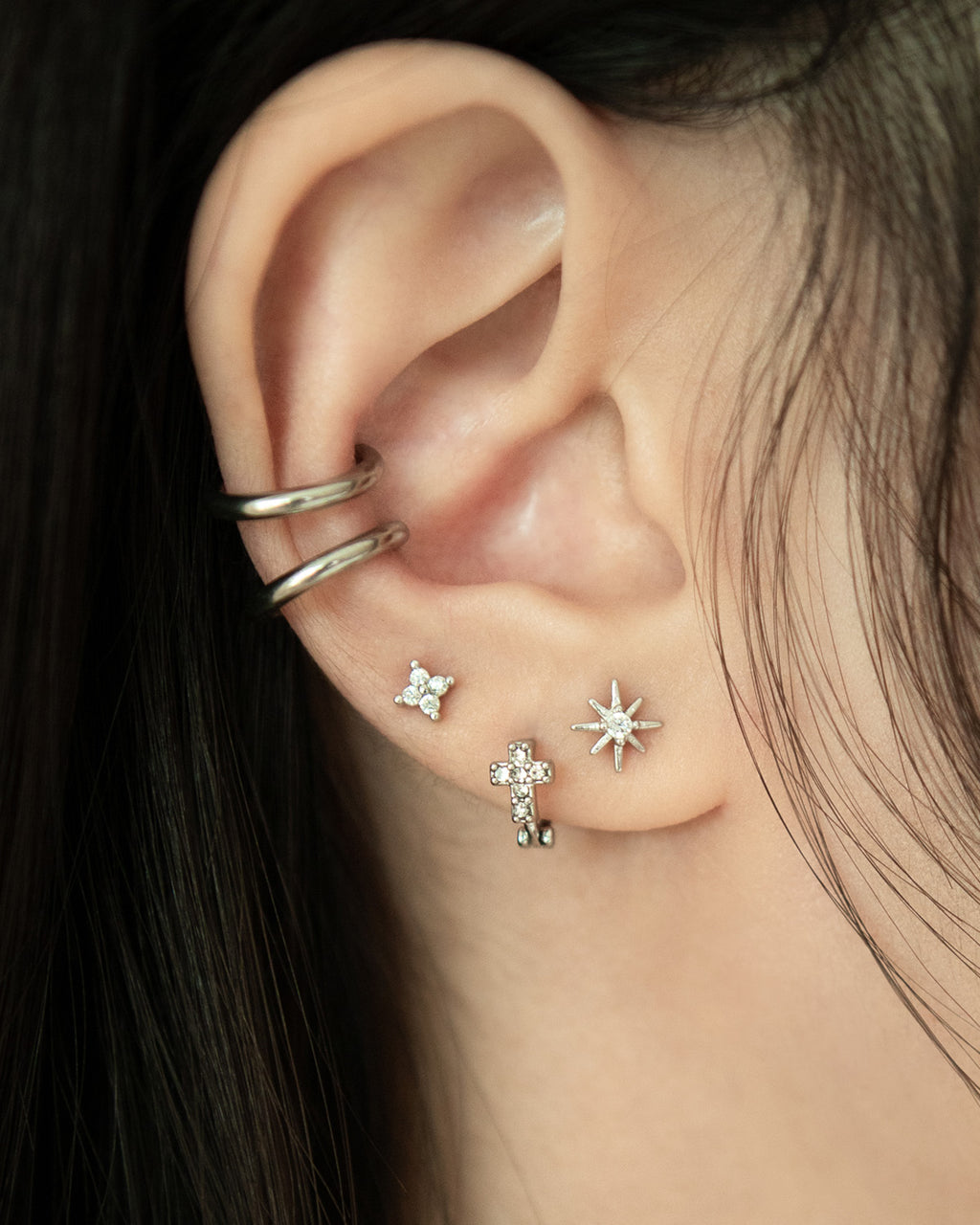 silver tiny stud earrings and petite huggie hoops by The Hexad Jewelry