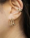single piercing stack consisting fiesta trio hoops and signature cult and moonshine ear cuffs