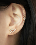 sparkly constellation shape ear studs in gold