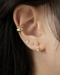 sparkly ear stack featuring dainty ear studs and sleek ear cuffs