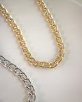 sparkly rhinestones woven with chunky chain details in the Trance choker from fashion jewelry label The Hexad