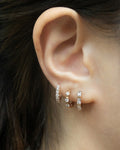 stack these three rose gold huggies for a trendy layered look by the hexad