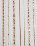 the hexad full collection of pinkish rose gold chain necklace designs to perfect your neck stack