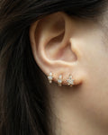 thick statement starlet and rosette huggie hoop earrings in rose gold