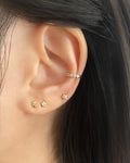 tiny subtle ear studs for casual off-duty look
