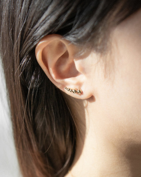 trending climber style earrings featuring tiny golden beads - The Hexad