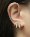 wear your shiny huggie hoops in a modern layered stack