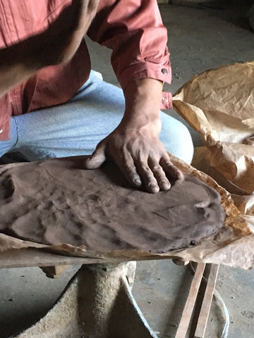 Process of making and shaping the clay for the black clay pottery of Manipur, India