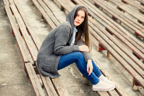 girl wearing cardigan and jeans