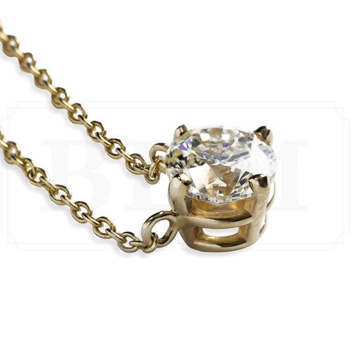 1.00 carat classic round diamond pendant in yellow gold
