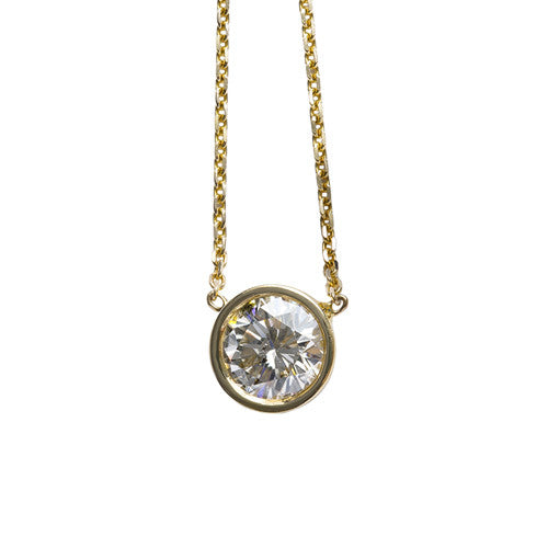 1.50 carat round diamond bezel pendant in yellow gold