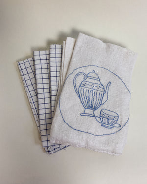 FIVE LINEN TOWELS, GRID AND EMBROIDERED