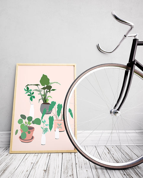 This would look great in my kitchen! This fun and modern botanical print art by Jules Tillman has a fresh, Jungalow style. With its millennial pink background and varying shades of green, white, terra cotta and grey, this wall art would make a joyful, stylish statement to your home.