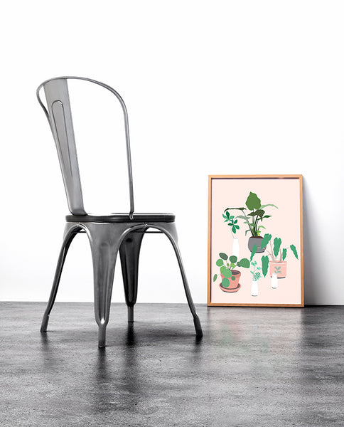 So sweet! This fun and modern botanical print art by Jules Tillman has a fresh, Jungalow style. With its millennial pink background and varying shades of green, white, terra cotta and grey, this wall art would make a joyful, stylish statement to your home.