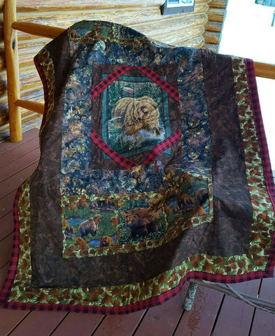 Hoffman Batiks and large scale bear prints combined to create a warm lap quilt for the fall months.