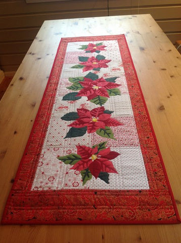 Mari Nordvik in Norway Wildfire Designs Alaska Poinsettia Too Table Runner