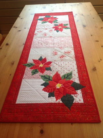 Mari Nordvik in Norway Wildfire Designs Alaska Poinsettia Too Table Runner Variation