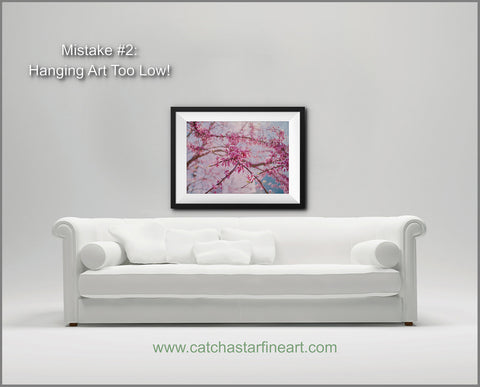 Are you making these 8 mistakes with your wall art?  Check out our free ebook with home decor tips to make your walls the best they can be! Hint: Number ONE is the most common mistake! #homedecor #howtohangart #howtohangartonwall #howtohangartabovesofa