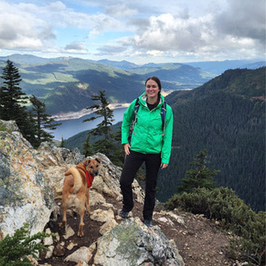 Woman with her dog over a mountain