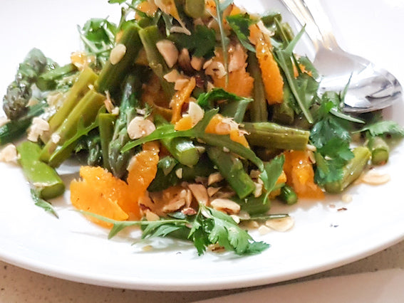Summer salad recipe. Fresh asparagus and orange salad. Vegan salad